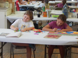 Girls Happily Coloring